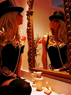 Burlesque dancer beauty top hat dressing room mirror
