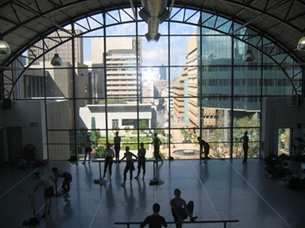 Dancers warm up for class in South African Mzansi Ballet's lovely Braamfontein studio.