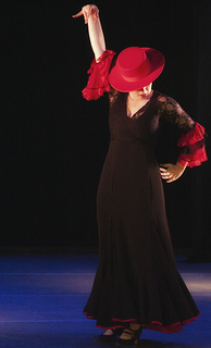 Flamenco dancer with red hat