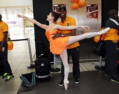 Soccer star Lucas Radebe tries his hand at ballet with Burnise Silvius during Joburg Ballet's airport flashmob with Mango Airlines.