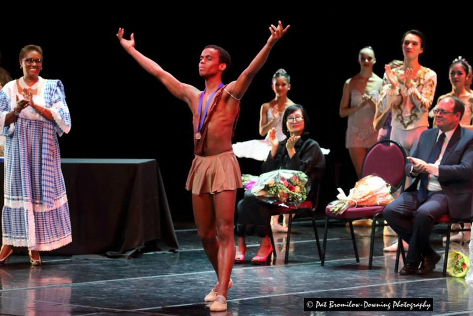Javier Monier receives his silver medal in the senior classical division at the 2014 South African International Ballet Competition.
